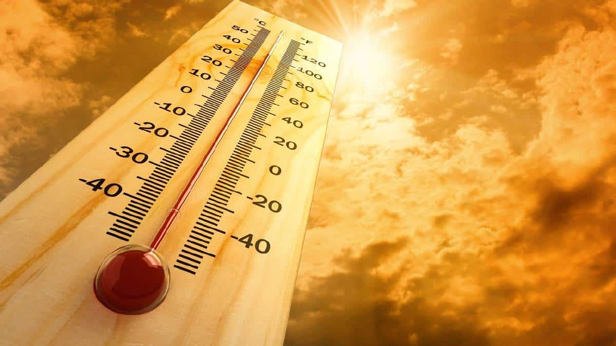 thermometer against a hot sky backdrop